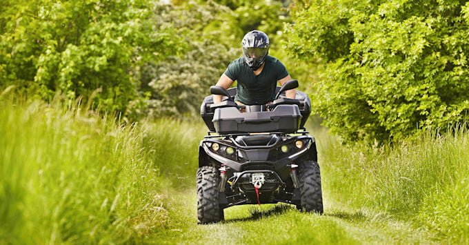 Man on  atv trail